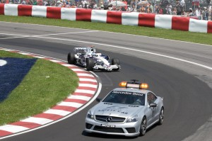 Nick Heidfeld follows the safety car